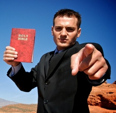 evangelist-with-bible-pointing