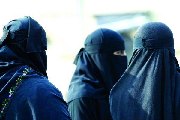 Muslim women wearing niqab face veils